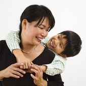 Son hugging mother — Stock Photo