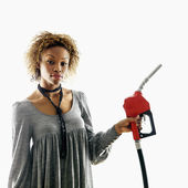 Woman holding gas nozzle — Stock Photo