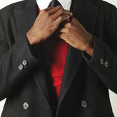 Man fixing necktie — Stock Photo