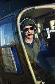 Male pilot in helicopter. — Stock Photo