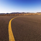 Yellow line on airport tarmac. — Stock Photo