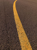 Yellow traffic line on asphalt. — Stock Photo