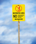 Restricted sign regarding water sports. — Stock Photo
