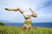 Woman doing headstand. — Stock Photo