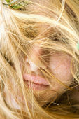 Face covered in hair. — Stock Photo
