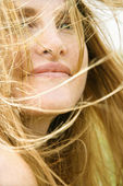 Woman's face in wind. — Stock Photo