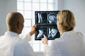 Doctors looking at xray. — Stock Photo
