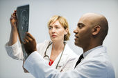 Physicians reading xray. — Stock Photo