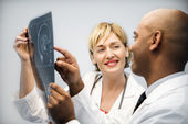 Physicians analyzing xray. — Stock Photo