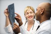 Physicians analyzing xray. — Stock Photo