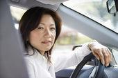 Woman at steering wheel — Stock Photo