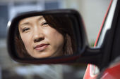 Serious woman in car mirror — Stock Photo