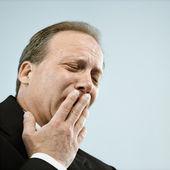 Businessman yawning — Stock Photo
