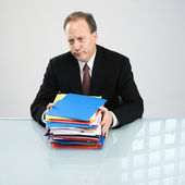 Businessman with workload — Stock Photo