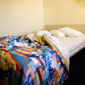 Unmade bed in room. — Stock Photo