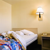 Unmade bed in motel. — Stock Photo