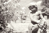 Infrared cherub statue at graveyard. — Stock Photo