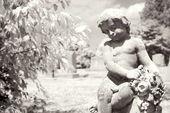 Infrared cherub statue at graveyard. — Stock Photo