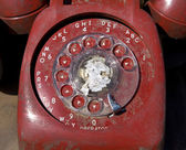 Old red rotary phone. — Stock Photo