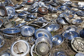 Old hubcaps on ground — Stock Photo