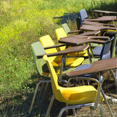 Old chairs in field. — Stock fotografie