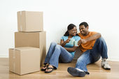 Portrait of couple with boxes. — Stock Photo