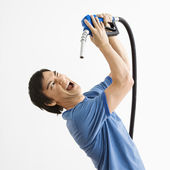 Man with gas nozzle. — Stock Photo