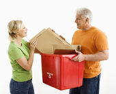 Man and woman recycling. — Stock Photo