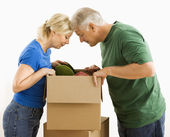 Man and woman looking in box. — Stock Photo