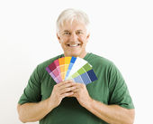 Man with paint swatches. — Stock Photo