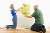 Man and woman painting wall. — Stock Photo