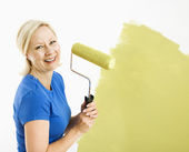 Woman painting wall. — Stock Photo