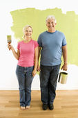 Couple with painting utensils. — Stock Photo