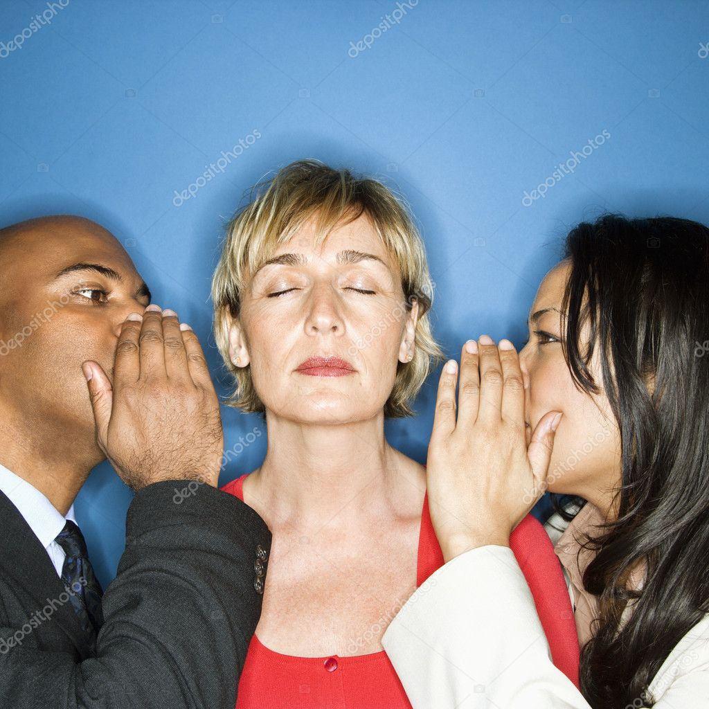 Businesspeople whispering into each ear of businesswoman. — Stock Photo #9311207
