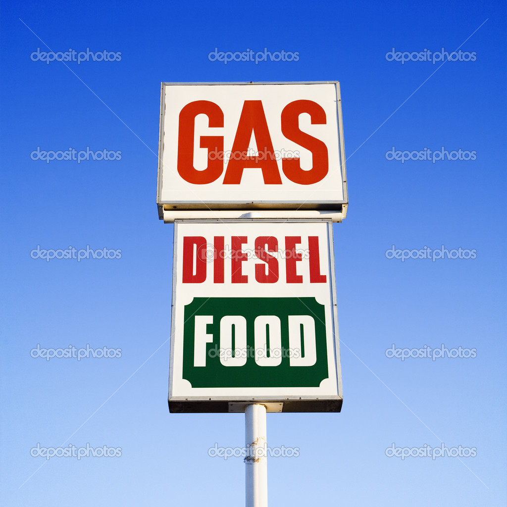 Sign against blue sky that reads gas, diesel and food. — Stock Photo #9311845