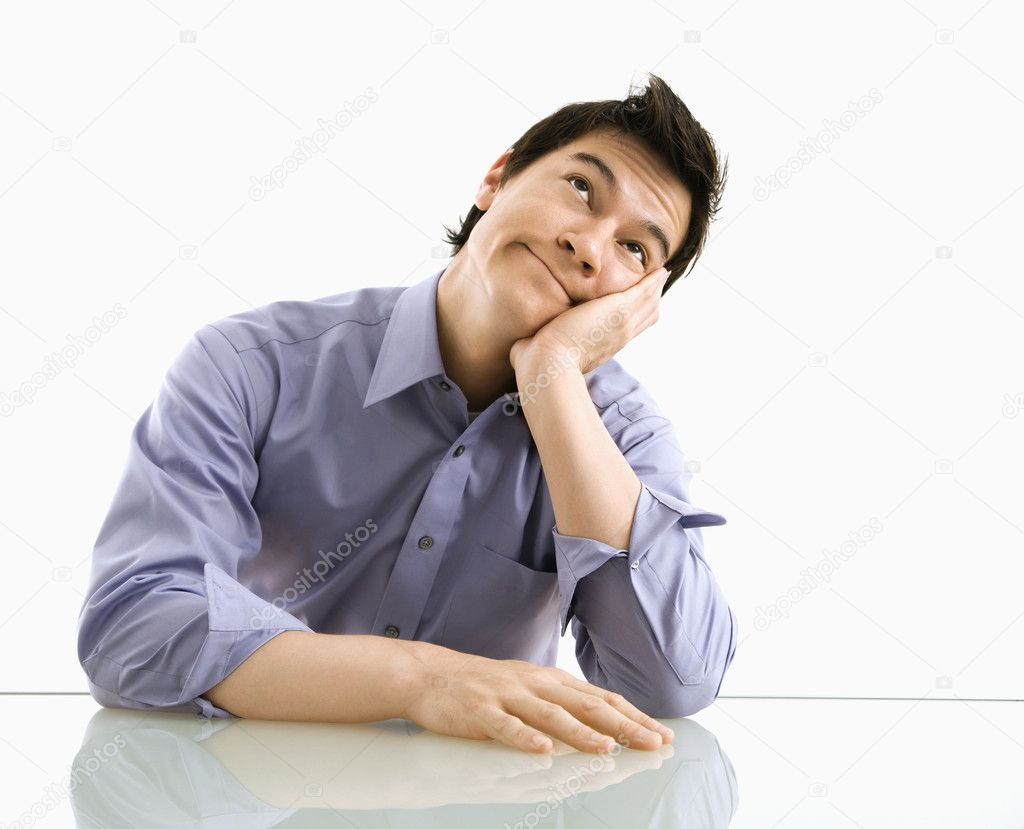 Young Asian business man sitting daydreaming. — Stock Photo #9312740