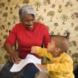 Grandmother and grandson coloring. - Stock Photo