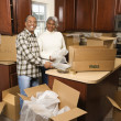 Couple unpacking boxes. — Stock Photo