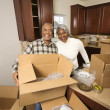 Foto Stock: Mature couple packing.