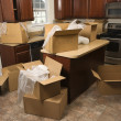 Moving boxes in kitchen. - Stockfoto