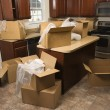 Moving boxes in kitchen. — Stock Photo