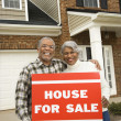 Couple selling house. - Stock Photo