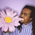 Man biting flower. — Stock Photo