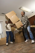 Man Dropping Stack of Boxes — Stock Photo
