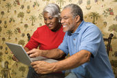 Mature couple with laptop. — Stock Photo