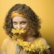 Woman smelling flowers. — Stock Photo