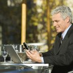 Businessman sitting outdoors. — Stock Photo