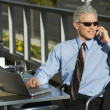 Businessman on cellphone. — Stock Photo #9330276