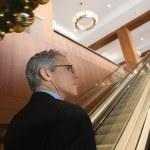 Businessman on escalator. — Stock Photo #9330295