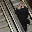 Businessman on Escalator with Cellphone — Stock Photo #9330296